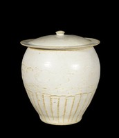 Jar with cover with incised cloud and floral designs.