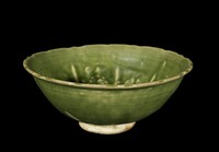 Bowl with notched rim and molded floral decoration.