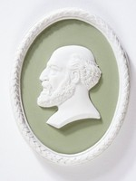 Oval sage green jasper medallion with white relief profile portrait of a man (Bruno Mond?), with white relief laurel leaf self-frame