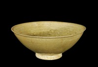 Bowl with dark olive glaze with molded pattern of four-petalled flowers and palm-like leaves, with five firing scars in well
