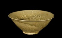 Bowl with molded design of three infant boys amidst flowers.
