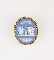 Oval blue jasper cameo with white relief of Sacrifice to Hymen, set in beaded gold mount as a brooch