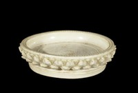 Round plate with incised lotus decoration and carved lotus-petal collar.