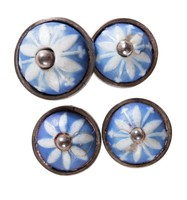 Four round blue jasper rosettes with white relief petals, set in silver as buttons