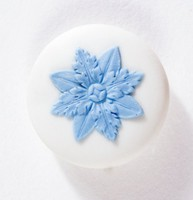 White jasper button with blue relief floral decoration