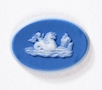 Oval dark blue jasper cameo with white relief of Cupid on a seahorse