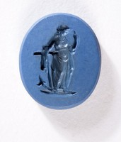 Oval dark blue jasper intaglio with figure of Hope with an anchor, back is blue and white variegated
