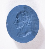 Oval dark blue jasper intaglio with cypher on one side and male profile portrait on the other