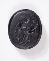 Oval black basalt intaglio with Hebe giving nectar to the eagle perched on an altar