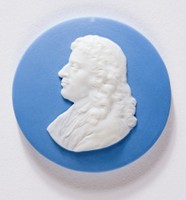 Round blue jasper medallion with white relief profile portrait of Moliere (1622-1673) facing left. Jean-Baptiste Poquelin, who took the stage name of Moliere, was born in Paris, the son of an upholsterer, who was also valet-de-chambre to Louis XIII. He studied under the Jesuits at the College de Clermont. In 1641 Moliere succeeded his father as the King's valet, but soon abandoned the appointment for the stage, joining a company of strolling players. For a time he came under the patronage of the Prince de Conti, and the King's brother, the duc d'Orleans. He first played before the King in 1658. In the following year his genius as a comic dramatist asserted itself, and the well known comedies began to flow from his pen. In 1665 Louis XIV adopted Moliere's troupe of players as his own, giving its director a pension of a thousand livres. His last play was the Malade Imaginaire. Moliere was ill when it was played, and the exertion produced a haemorrhage from which he died a few hours later.