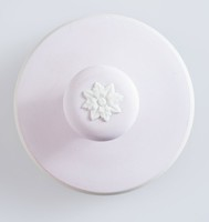 Drawer pull with impressed floral design