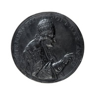 Round black basalt papal medallion with profile portrait of Clement XII facing right