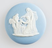Round blue jasper cameo with white relief scene of Cupid masked, set in heavy brass frame with ring