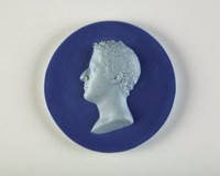 Round portrait medallion of gray-blue jasper laminated between two dark blue jasper dip surfaces, with a gray-blue portrait bust of a man to left.