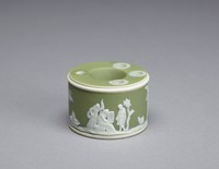 Green jasperware inkwell with white relief design of a group with cage and one other group of figures along with the typical wedgwood  trees and flowers