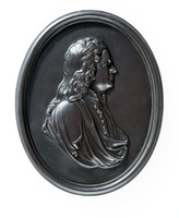 Oval basalt self framed medallion with profile portrait of the famed mathmetician and scientist Sir Isaac Newton (1642-1727) facing right.