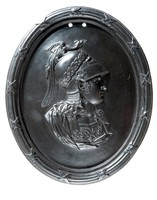 Oval basalt medallion with profile portrait of Alexander the Great (356-323BC) facing right within a self framed border. Alexander was a Greek soldier, son of Philip of Macedon, born in Pella, and educated by Aristotle. At an early age he showed military talent of a high order, crossing the Hellespont in 334 to defeat a Persian army led by Darius. He consolidated this victory by occupying Palestine, marching thence to Egypt where he was hailed as a deliverer from Persian tyranny. He founded Alexandria in 331 B.C., and again defeated Darius in the same year. By 329 he had reached the river of Jaxartes, and in 328 subdued the whole of Sogdiana. In 326 he attempted the conquest of India, establishing Greek colonies in the Punjab, and bringing Greek influence to the art in the East, Returning to Babylon he began to plan for further conquests, but was taken ill after a banquet and died eleven days later. His body deposited in Alexandria in a soldiers coffin.
