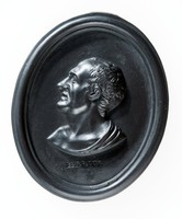 """Oval black basalt medallion with relief profile portrait of Marius facing left (157 BC-86 BC) Gaius Marius was a Roman general and statesman. Holding office of consul and unprecedented seven times during his career. Also noted for his important reforms of Roman armies, authorizing recruitment of landless citizens and reorganizing the structure of legions into separare cohorts. Marius defeated the invading Germani tribes for which he was called """"the third founder of Rome."""" His life and career were significant in the transformation of Rome from Republic to Empire."""
