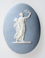 Oval blue jasper medallion with white relief female figure holding a floral sprig