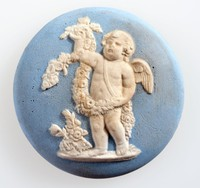 Round blue jasper medallion with white relief of putto with garlands from the four seasons