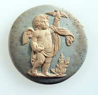 Round blue jasper medallion with white relief of putto with bird meant to be one of the four seasons by William Hackwood this one representing spring.