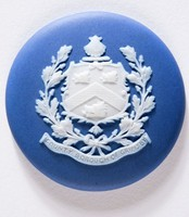 Round dark blue jasper medallion with white relief coat-of-arms of County Borough of Grimsby made as a souvenir for people to buy when they went on holiday to the sea sides towns around the United Kingdom popular in the Victorian and Edwardian times.
