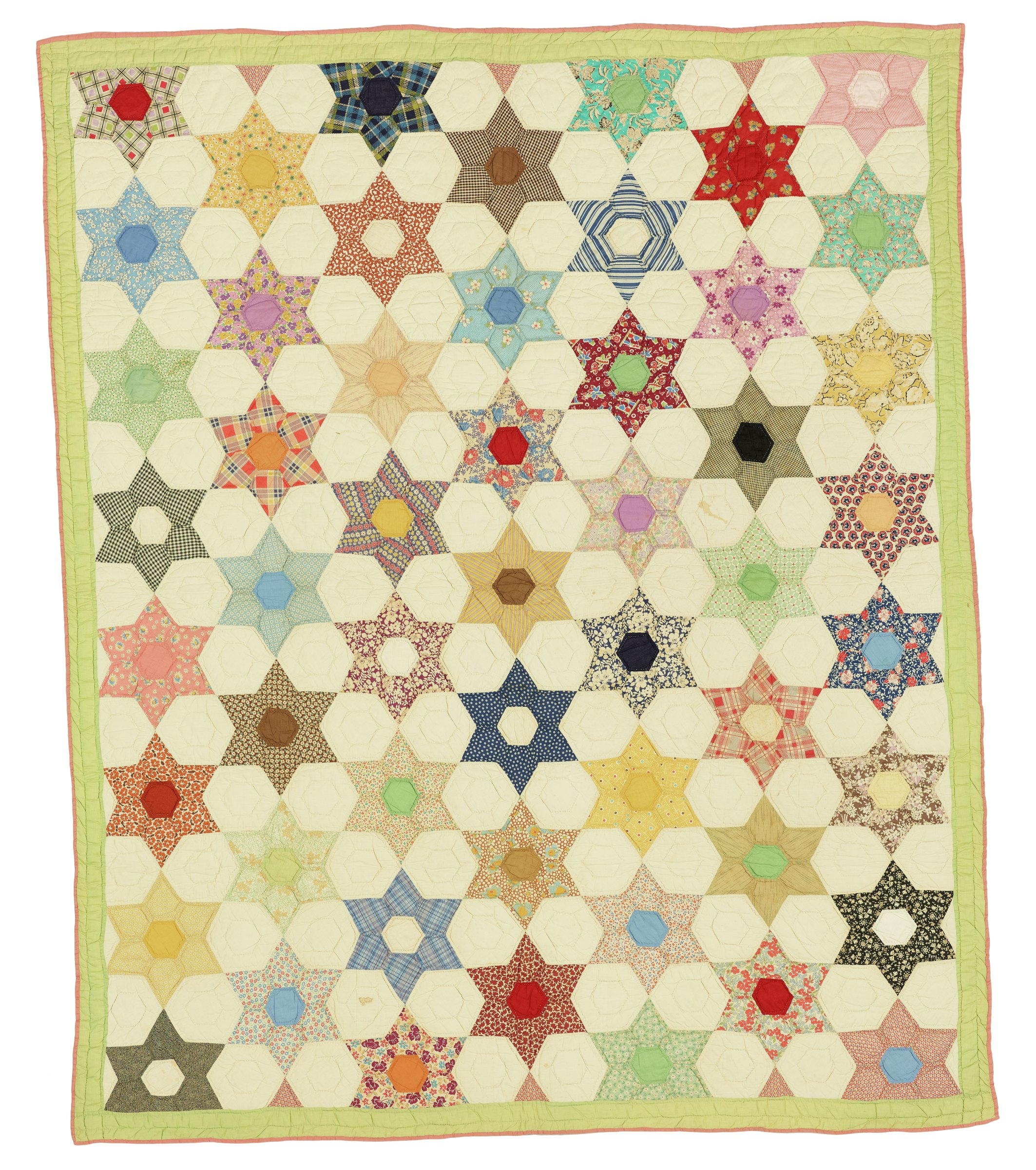 """Large rectangular quilt made of cotton feed sacks in the """"Six-Pointed Star"""" pattern, pieced of small six-pointed stars in a variety of patterns and colors between white hexagons, edged in pale green with a narrow pink binding."""