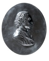 Large oval basalt medallion with profile portrait of Joseph Priestley (1733-1804) facing right, decorated by Albert H. Bentley.