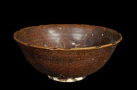 Bowl with notched rim and molded floral designs, lotus pod in well.