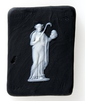 Square lab trial for a black jasper plaque with white relief of Thalia. Thalia is one of the nine Muses. She is the muse of comedy and holds a mask and a shepherd's crook modelled by John Flaxman in about 1776