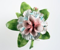 Wedgwood bone china floral brooch with one blue, white and pink flower against green leaves on a metal mount
