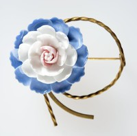 Wedgwood floral brooch featuring a bone china flower on a metal mount