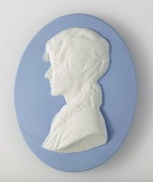 Oval blue jasper medallion with white relief profile portrait of a modern unidentified woman facing left