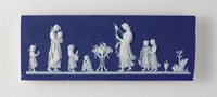 """Small, rectangular plaque of white jasper with dark blue jasper dip and white relief with figures of women and children from the """"Domestic Employment"""" series after Elizabeth Lady Templetown, a Lady of the Royal Household, who was a skillful silhouette artist and submitted designs for Wedgwood's use."""