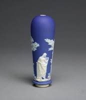 Large, heavy beer pump handle of white jasper with dark blue jasper dip and white relief decoration, the body with on one side the figure of Aesculapius, god of medicine, between two trees and on the other the figure of a draped female, perhaps Hygeia, daughter of Aesculapius and goddess of health.