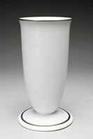 Tall, bullet shaped vase, Keith Murray shape 4325, that rests on a wide foot, finished in a blue matte with platinum lustre trim on the rim of the mouth and on the base.