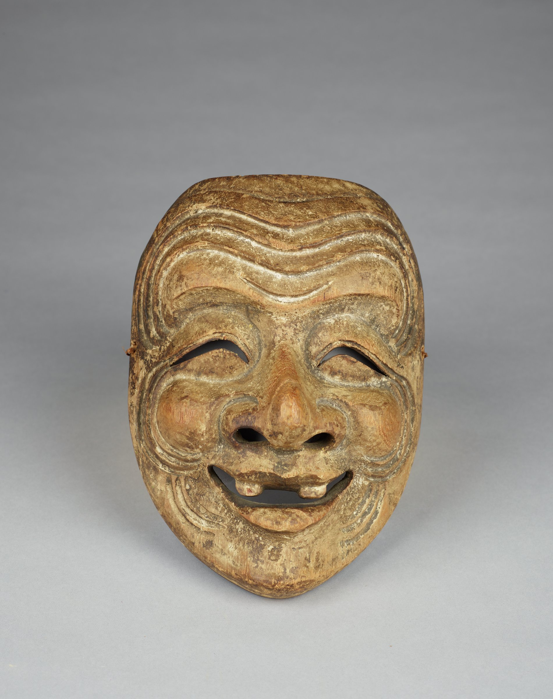 Old laughing man with two teeth