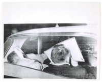 """Press print with caption (verso) """"Negro Church Bombing Arrests / Birmingham, Alabama: Two men hide their faces from the news cameras as they are driven to jail here yesterday as suspects in the recent bombing of a Negro church in Birmingham, when four young negro girls died. The men were identified as R. E. Chambliss and Charles Cagle. 30th September 1963"""""""