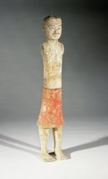 Small standing figure of a male attendant with painted details and clothing. Missing arms that would have been made and attached separately.