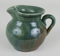 Creamer, Miller Pottery, Alabama, Perry County, stoneware with Albany or Michigan slip and white feldspar glaze, blue pieces tinted with cobalt