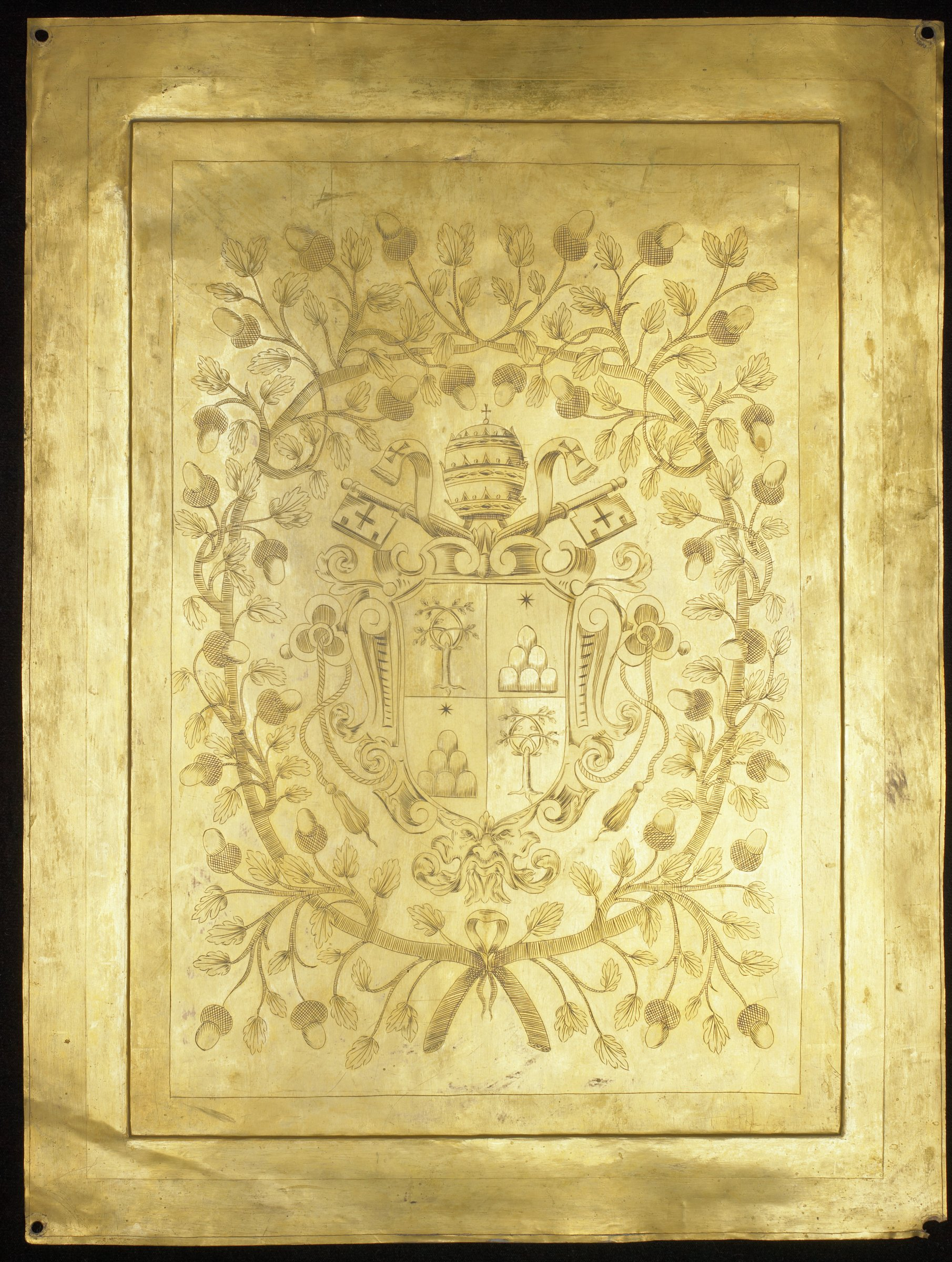 Thin metal plate decorated on a raised central panel with a line engraving of the coat-of-arms of Fabio Chigi, Pope Alexander VII (1599-1667). Chigi family coat-of-arms is made of a shield divided into quarters with six mountains and a star in two panels, and an oak tree in two panels. The shield is surmounted by a papal tiara and two keys, typical of papal arms. The entire coat-of-arms is surrounded by a garland of oak leaves and acorns.
