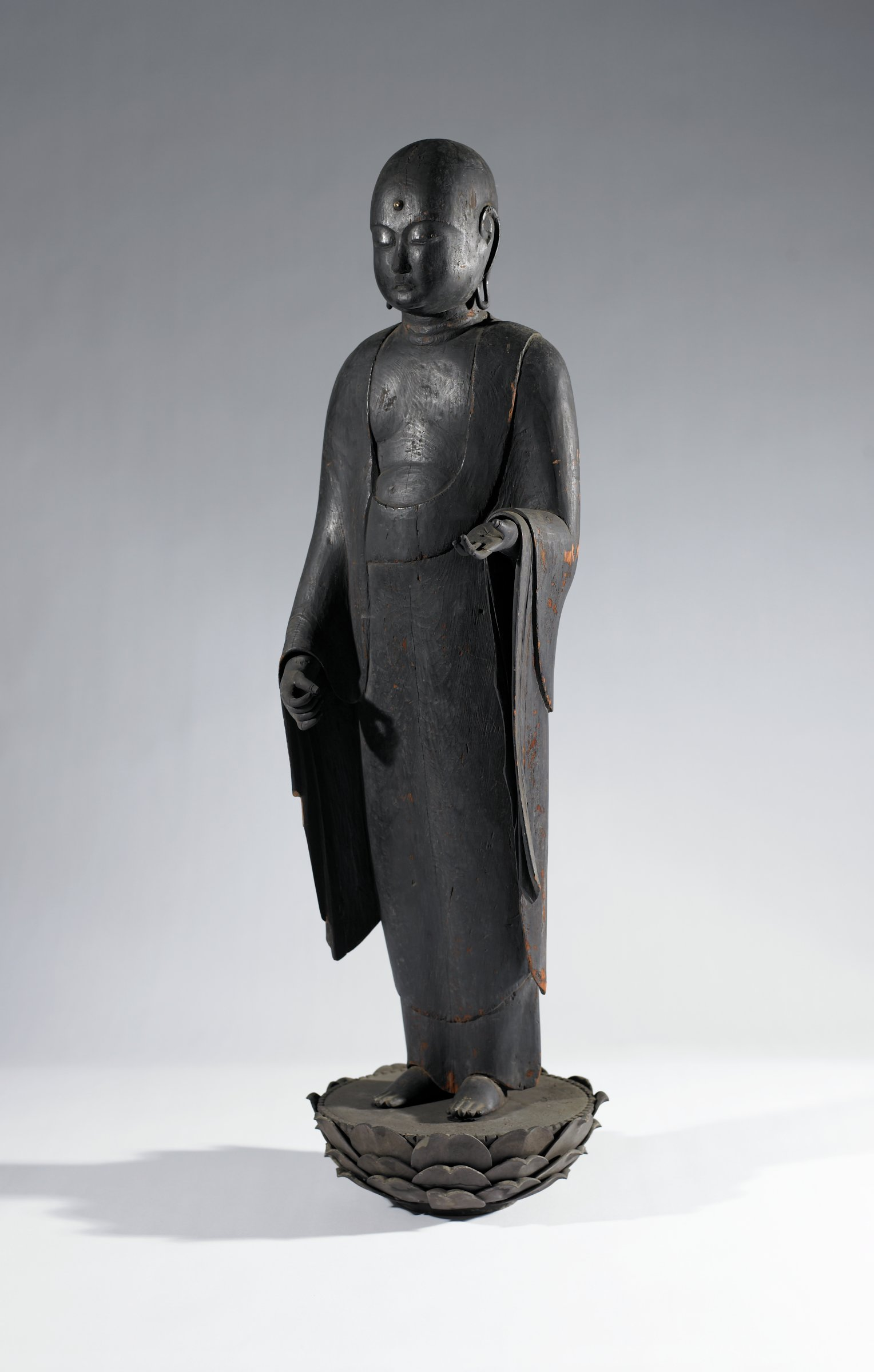 """A large standing image of Jizo Bosatsu carved from a single block of wood, """"Natabori"""" or Axe cut style"""