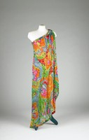One-shoulder, draped toga-style evening dress in multi-colored silk with sequins and beads in shades of red, blue, orange, yellow, green and pink over close fitting multi-colored silk under dress of same fabric with slit on left side, side zipper, lined in hot pink silk