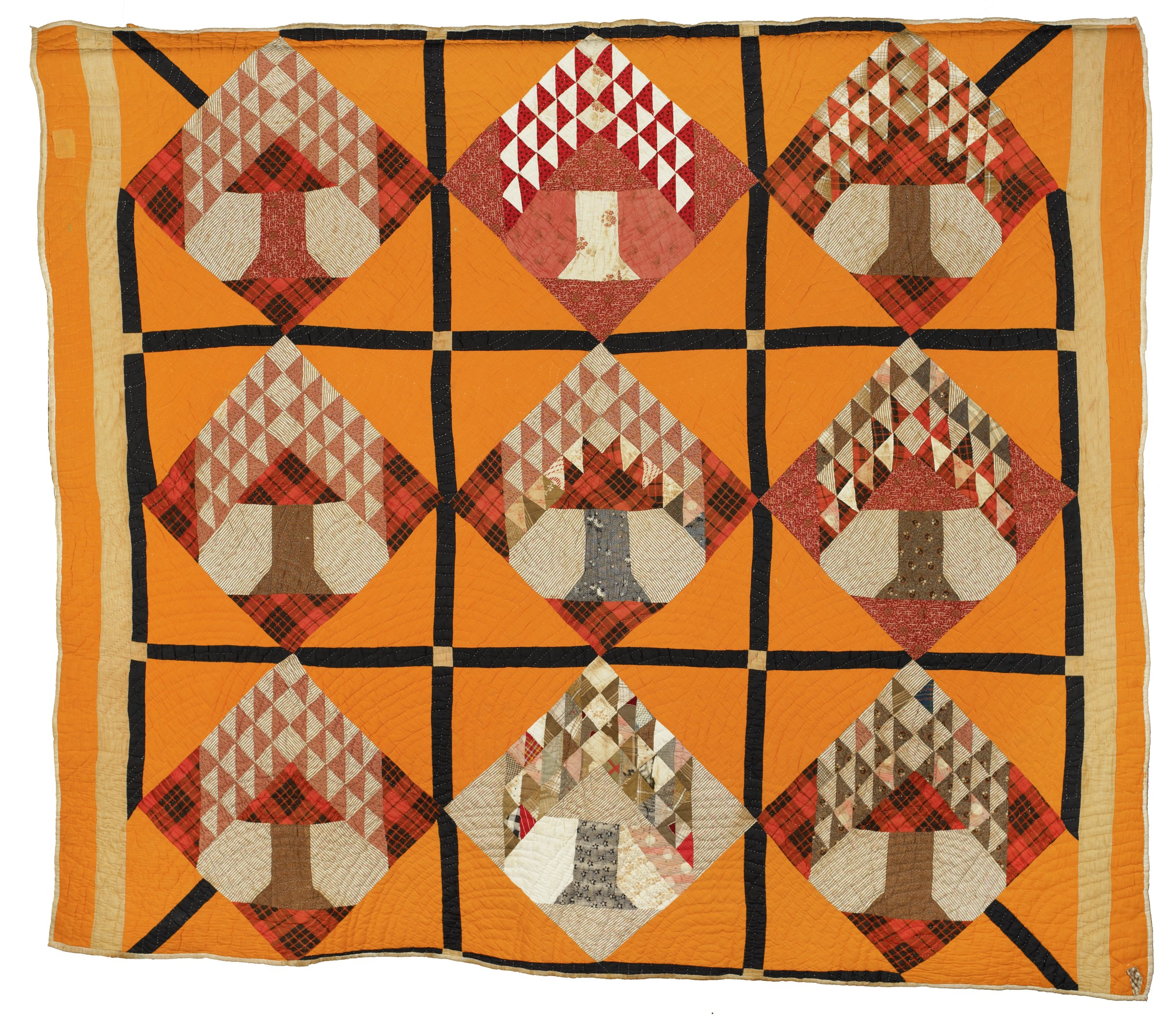 Large quilt in the Tree of Life, or Pine Tree, pattern comprised of a variety of printed and solid cottons forming a grid of nine blocks, each containing a diamond shape with a flowering tree inside it against an orange ground outlined by black strips, at each corner block a black strip extends directly from the corner to the diamond.