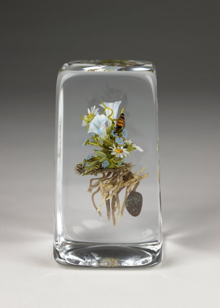 Clear glass with flower and honey bee