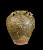 """Glazed stoneware jar with four applied tiger handles with the character for """"king"""" carved on their foreheads, and two applied dragons chasing pearls of wisdom."""