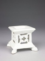 Large standing salt of white tin-glazed earthenware, square in shape on four feet and with pierced sides, the square top with a shallow pool in center to hold salt.