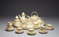 Miniature coffee and tea set with pattern #348 (gold wreath between two red lines). Set consists of teapot, coffeepot, hot water kettle, tea caddy, sugar bowl with cover, creamer, tray, six saucers, five teacups without handles, and three cups with handles.