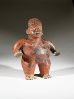 Hollow standing nude female figure, red-slipped, with arms outstretched, palms facing down, cap on head. Large, c-shaped ears, open eyes with clearly articulated almond-shaped rims, and slightly opened mouth. Fingers and toes spread, nails articulated.