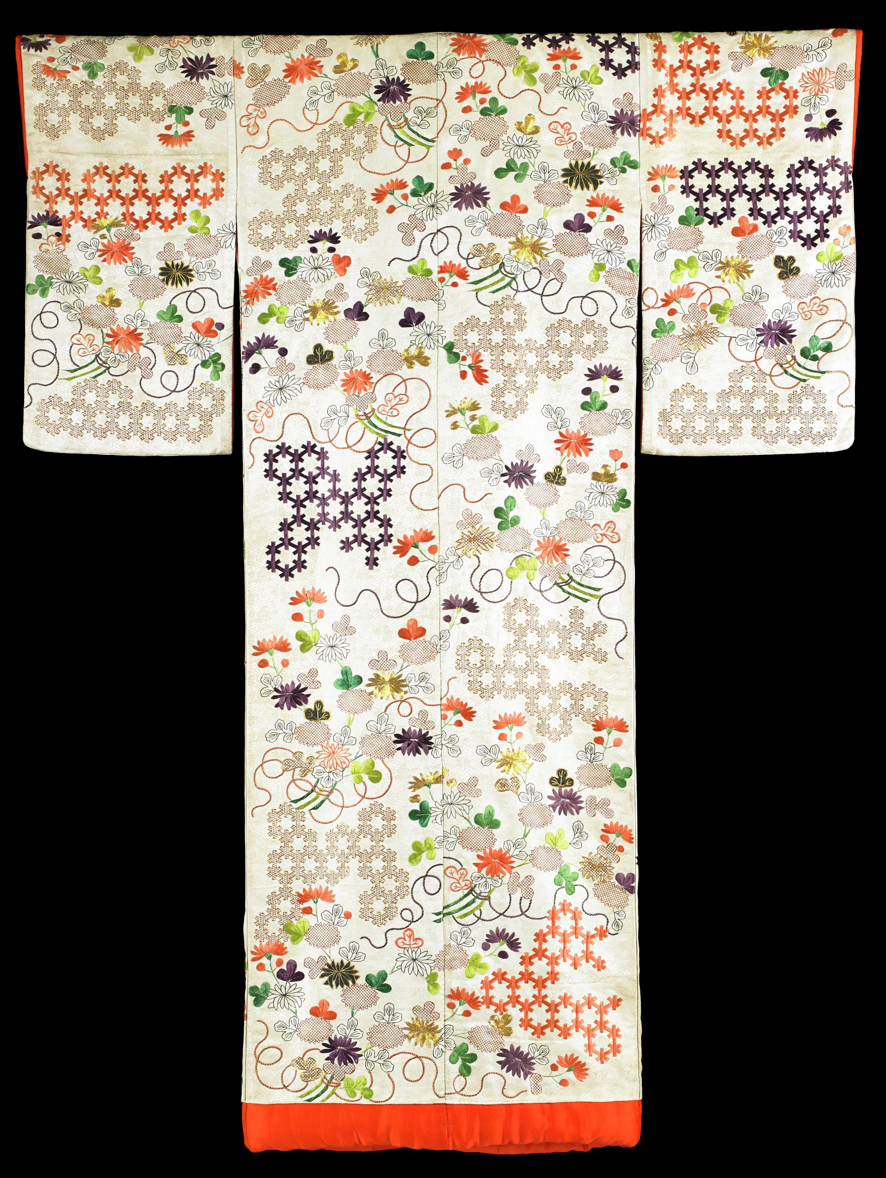 Traditional wedding kimono of cream-colored ground and orange-red lining; designs of floral sprays interspersed among interlocking hexagons; decorations are applied by combination of brush painting, dye-stamping, embroidery and couched gold threads